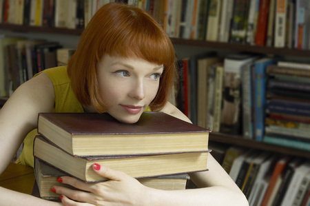 higher intelligence: woman leaning on pile of books