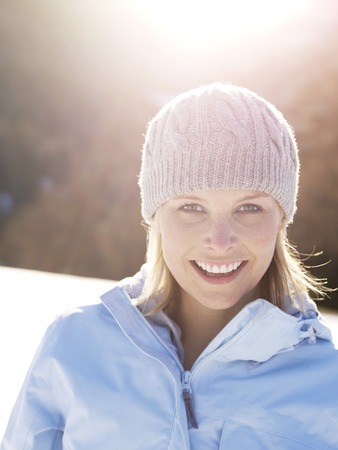 woman smiling portrait in snow