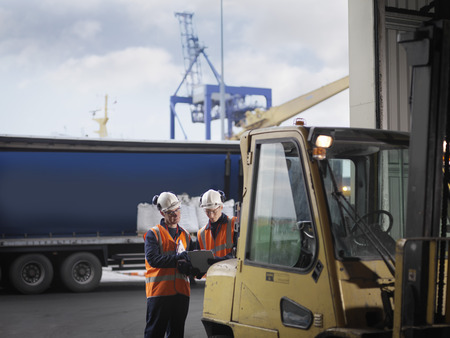 reviews: Port Workers With Forklift Truck