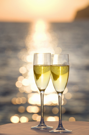 Two glasses of champagne at sunset LANG_EVOIMAGES
