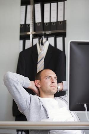 musing: man sitting at desk thinking