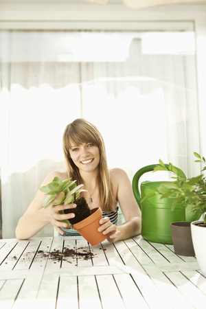 planted: Young woman and plants on patio