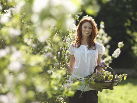 Woman With Apple Blossom In Orchard