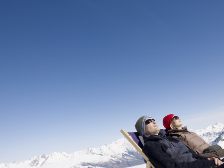sweethearts: man and woman on deck chair up mountain LANG_EVOIMAGES