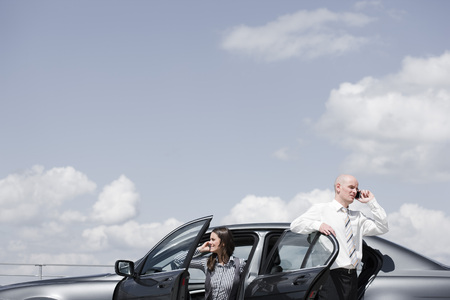 approaches: man and woman near car on the phone