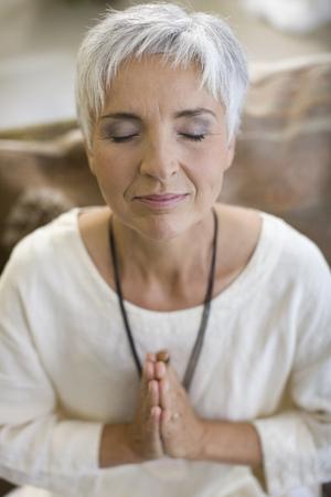 pleaded: meditating woman LANG_EVOIMAGES