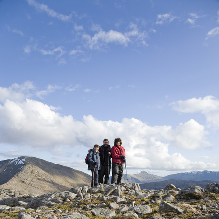spiritual beings: Father & Sons on Summit of mountain
