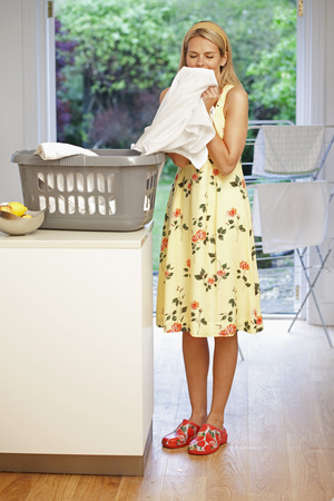 yielded: Beautiful young housewife doing laundry