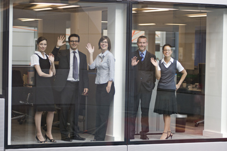accomplishes: Portrait of five business people