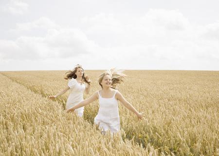 pursued: Girls running in wheat field