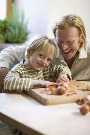 instructs: father and son in kitchen