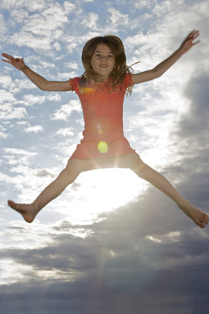 low spirited: Young girl jumping into the air
