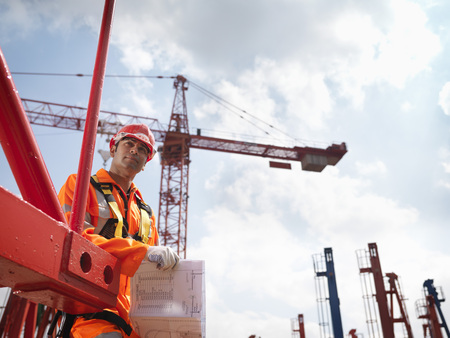 safeguards: Crane Worker With Notes LANG_EVOIMAGES