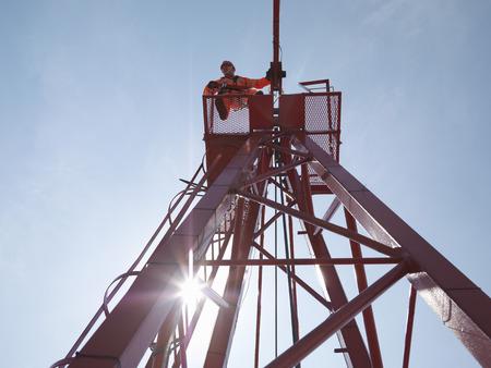 Crane Worker Looking Down From Crane