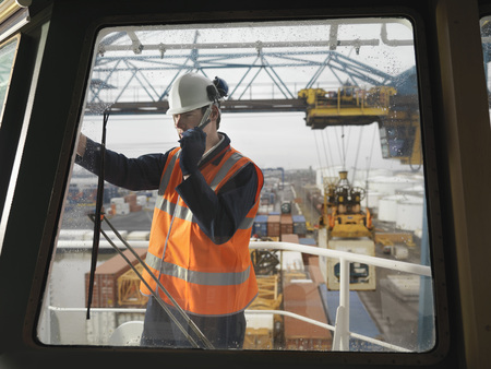 shipped: Port Worker With Walkie Talkie On Ship LANG_EVOIMAGES