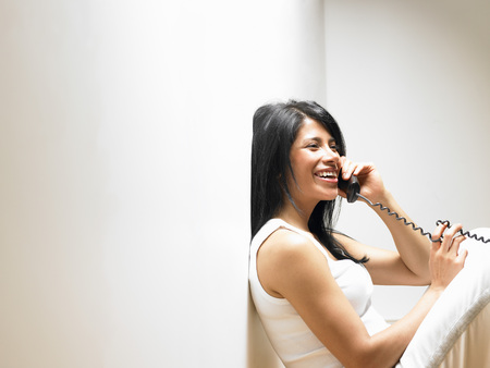 talker: Woman on the phone, smiling