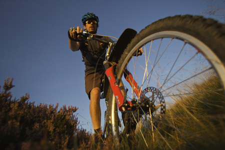 Mountain biker riding on a trail LANG_EVOIMAGES
