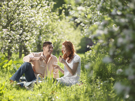 flowered: Couple Having Picnic In Orchard LANG_EVOIMAGES