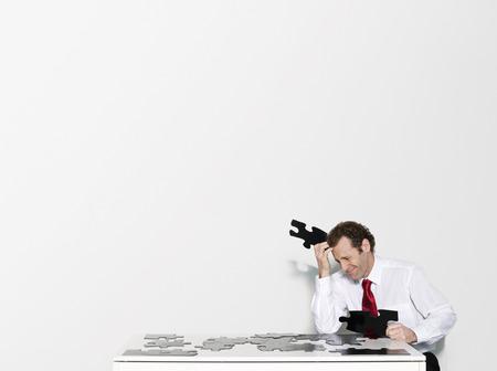 motivations: A business man doing a jigsaw