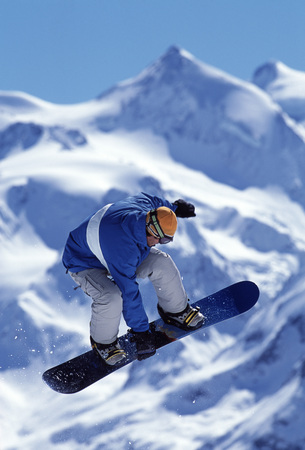 exhilarating: Snowboarder jumping into the air
