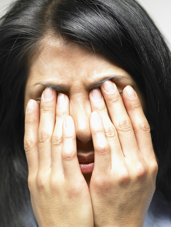 sickly: Woman with her hands on her face