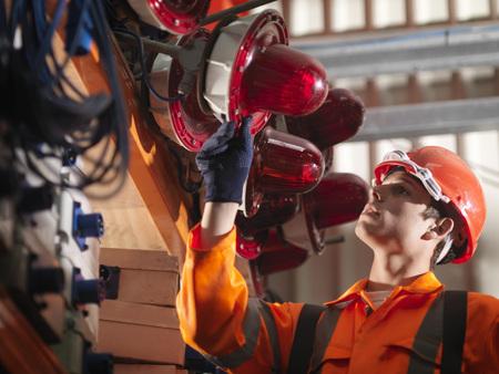 defended: Crane Worker Checking Safety Lights