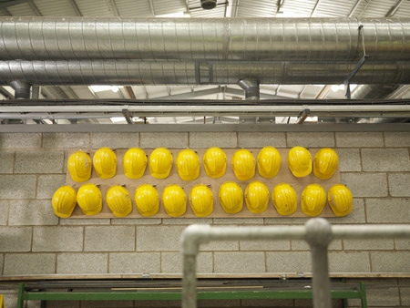 conforms: Rows Of Yellow Hard Hats