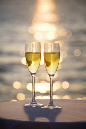 suns: Two glasses of champagne at sunset LANG_EVOIMAGES