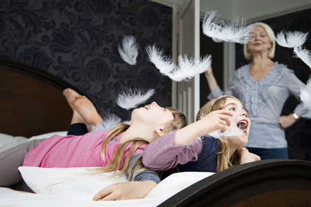 scolded: Granny disapproves girls pillow fighting