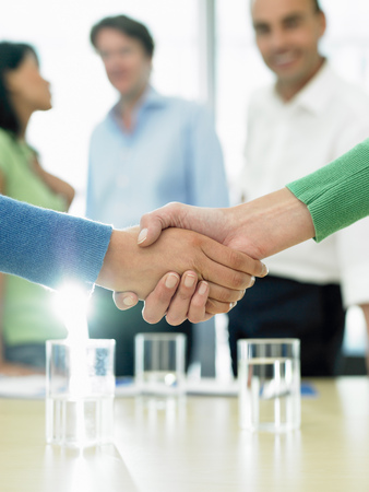 Closing a business deal by shaking hands