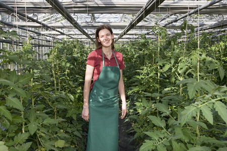 conservatories: woman in greenhouse