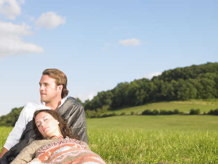passions: young people lying in field