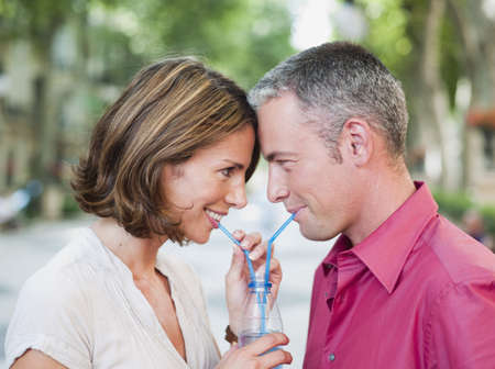 passions: couple drinking out of same glass