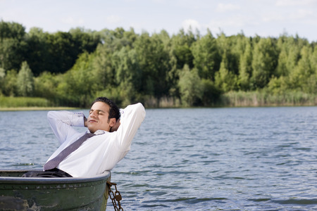 context: businessman lying in rowboat