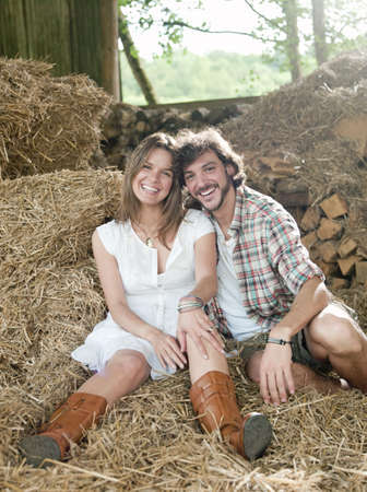 passions: Man and woman lying in hay barn