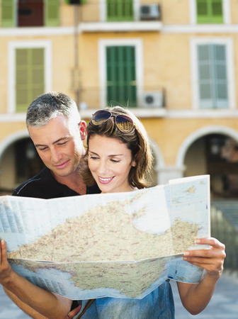 sightseers: couple looking at a map