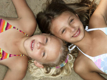 new age: Portrait of girls on a beach LANG_EVOIMAGES