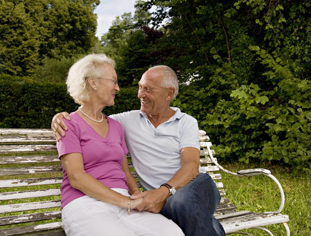 cherished: senior man and woman on old bench LANG_EVOIMAGES