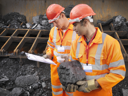 defended: Coal Workers Inspecting Coal