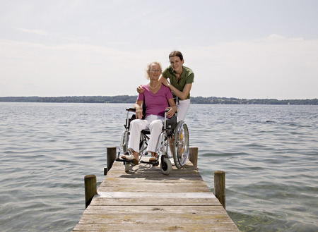 hinder: woman and senior woman in wheelchair