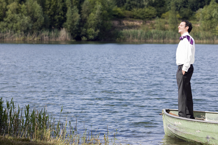 context: businessman in standing in rowboat