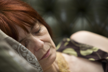 doze: Mature lady Sleeping on couch