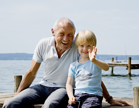 waved: boy with grandfather on pier at lake LANG_EVOIMAGES