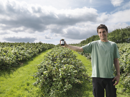 Man With Blackcurrant Jam In Field
