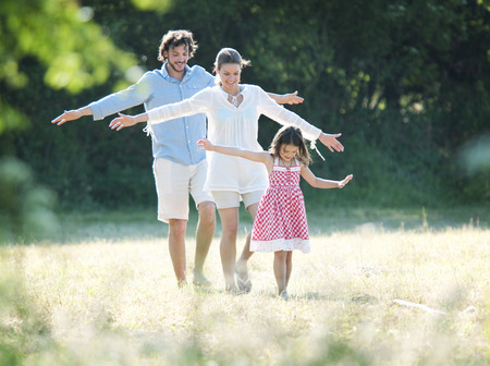 pursued: Family fun walking in country field