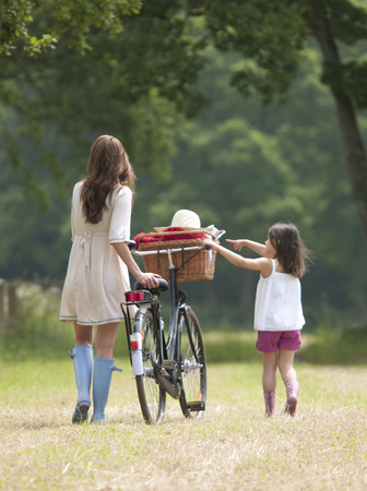 Mother and child with bike and picnic