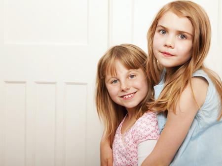 Portrait of two girls hugging LANG_EVOIMAGES