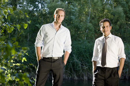out of context: two businessmen standing in nature LANG_EVOIMAGES