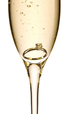 proposed: Engagement ring in glass of champagne
