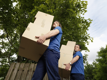 distributing: two men carrying boxes LANG_EVOIMAGES
